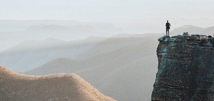 man overlooking expanse